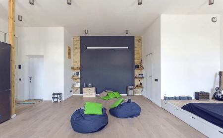 Интерьер просторной квартиры-студии в стиле «лофт»