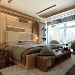 Деревянные панели на стене и полка с книгами в спальне